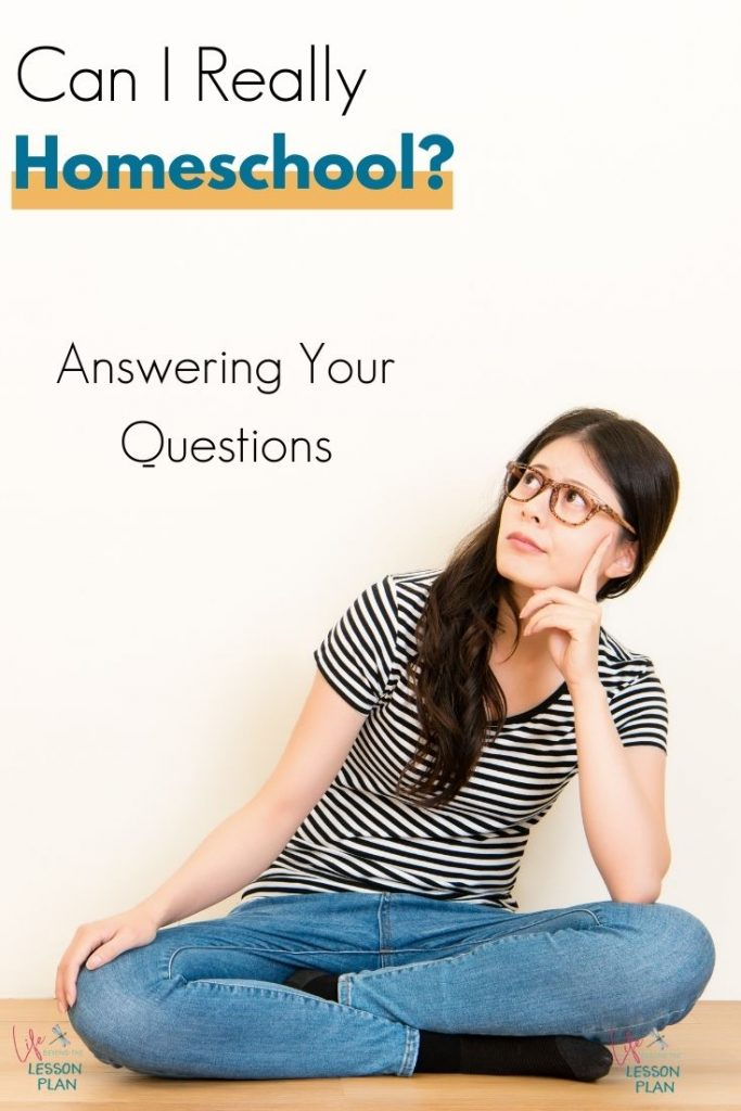 woman sitting on the floor with a questioning look
