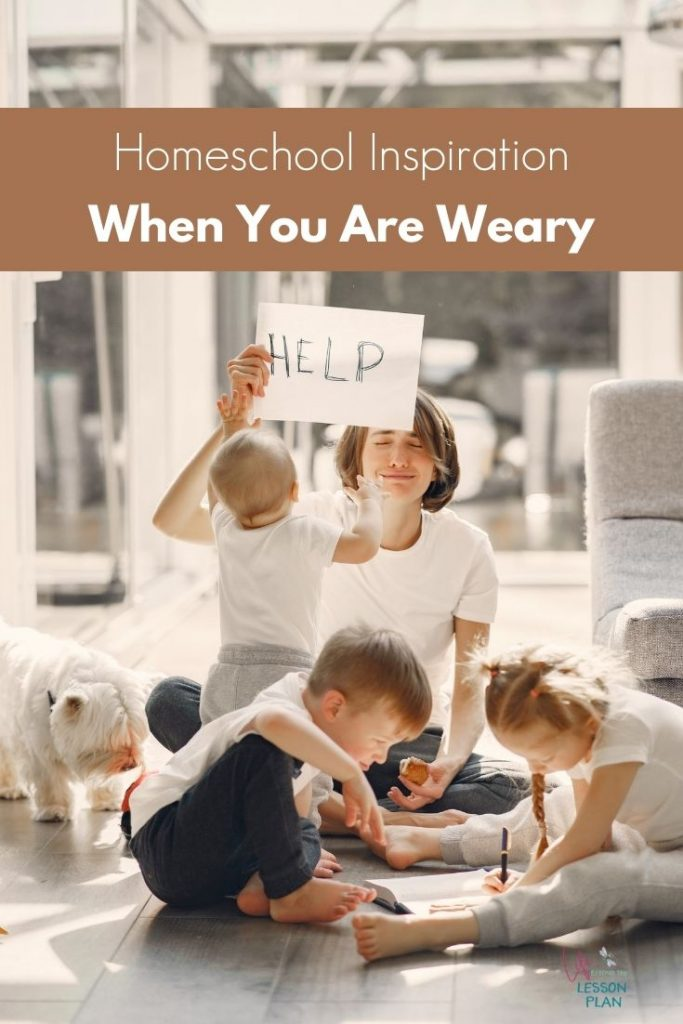 """homeschool mom with 3 kids holding a """"help"""" sign"""