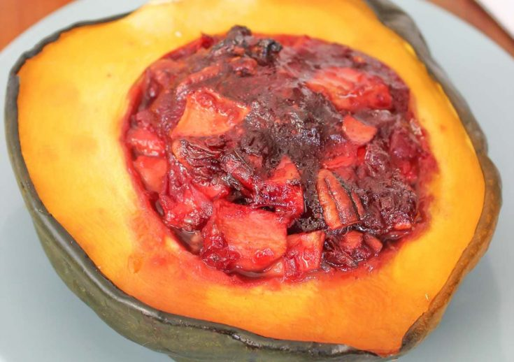 Pan Roasted Acorn Squash Stuffed with Apples Cranberries and Pecans