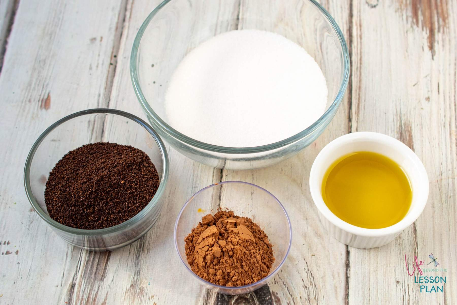 DIY Mocha Body Scrub ingredients in separate bowls